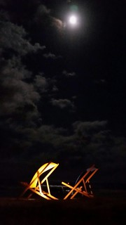 Giant deck chairs under the moon.