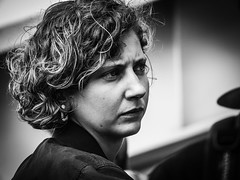 Frown and Curl (Maarten Baars) Tags: frowning frown curls curly people ordinarypeople street streetportrait streetlife streetview streetphotography streetphoto streetstories streetstyle urbanphotography urbanandstreet panasonic45175mm panasonicgx80 pa mirrorless microfourthirds micro43 amsterdamcentralstation ndsm ferry faces blackandwhite blackwhite monochrome woman young portrait candidportrait candid