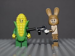 Corn Cob guy does not want to become popcorn ! (N.the.Kudzu) Tags: tabletop lego minifigures corncobguy bunnysuitgirl canondslr canonefslens