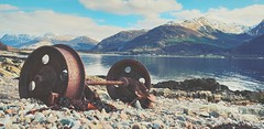 'Off the Rails' (Mark.L.Sutherland) Tags: steel forged axle trainwheel cast fortwilliam beach loch lake water fjord hills scotland uk unitedkingdom britain railwheel marksutherland pov pointofview angle lowdown shingle wheelset metal abandoned rusty old amaturephotographer samsung galaxys9plus cellphone phonecamera phoneography androidography corbetts snapseed postediting circles