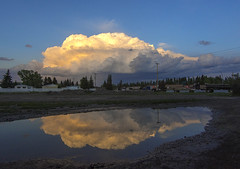 Storm chasing and puddle jumping (Len Langevin) Tags: weather wx stormseason thunderstorm stormchasing puddle reflection sunset sky cloud alberta canada nikon d7100 tokina 1116