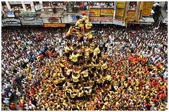Up above the world so high (Ashish T) Tags: people india yellow festival asia pyramid indian crowd culture celebration human bombay 500 mumbai humanpyramid dadar govinda janmashtami gokulashtami ashisht justpeople ashishtibrewal lpfestasiapacific