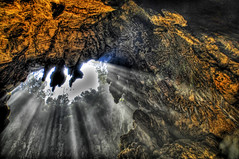 Spelunking in the Batu Caves (Stuck in Customs) Tags: nikon hole smoke exploring d2x malaysia cave kualalumpur hdr batu batucaves streaming spelunking d2xs abigfave