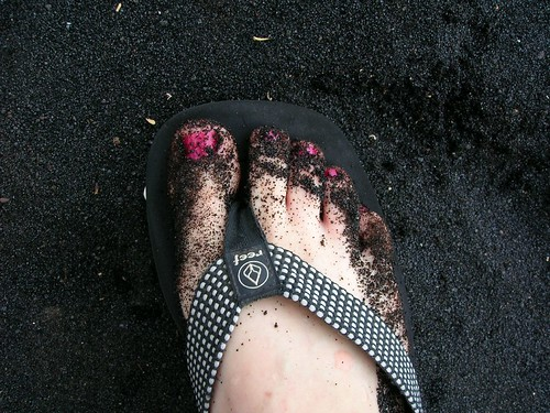 my black-sand covered toes