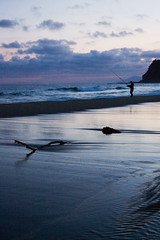 Fishing at Garie (Lil [Kristen Elsby]) Tags: sunset sea beach nature silhouette landscape nationalpark fishing fisherman waves tide australia driftwood nsw newsouthwales australasia garie royalnationalpark oceania gariebeach