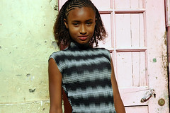 girl (united*colours) Tags: africa pink black girl beautiful wall hair eyes pinkdoor caboverde capeverde