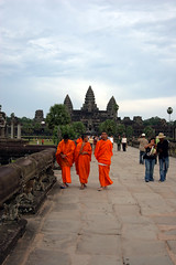 Monks in front of Angkor Wat (tigri) Tags: travel portrait people orange temple person worship asia cambodia religion monk buddhism siem reap southeast angkor anastefanovic