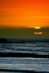 mata hari (Farl) Tags: travel sunset sea bali orange sun colors indonesia coast waves quality horizon shore jimbaran