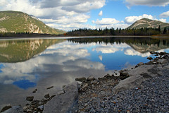 Drop to the Sky (Picture Pages by Patrick) Tags: trees sky lake canada mountains reflection nature water grass clouds canon landscape 350d rocks alberta waterscape canadianrockies lacdesarcs