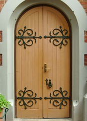 Church door with wrought iron hinges