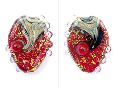 Nothing is Real (sarah hornik) Tags: red black glass gold beads strawberry bubbles lampwork raku focal nothingisreal