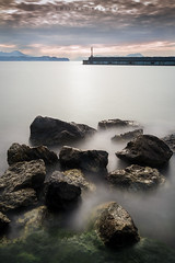Returning to a certain place. (Emykla) Tags: mare sea bacoli napoli campania italia italy nikon d3100 alba dawn sunrise long exposure faro lighthouse rocks scogli nuvole clouds