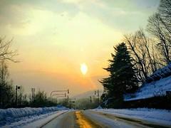 Processed Flaming Sun (sjrankin) Tags: 3january2018 28march2018 edited sunset sky sun clouds cold snow reflection yubari hokkaido japan road