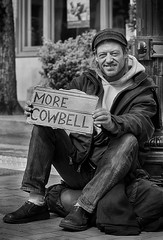 What The World Needs Now Is....... (Ian Sane) Tags: ian sane images whattheworldneedsnowis homeless man sign morecowbell street portrait photography black white monochrome downtown portland oregon pioneer courthouse square southwest morrison canon eos 5ds r camera ef70200mm f28l is usm lens
