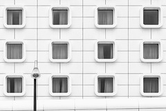 Windows 12 (beta-version) (Leipzig_trifft_Wien) Tags: marseille provencealpescôtedazur frankreich fr window repeating facade white black monochrome architecture geometry lines lamp pole disturbance minimalism structure city urban building bnw bw reflection pattern modern contemporary