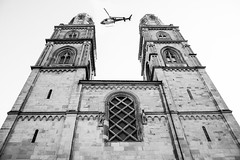 The police looks over Zurich. (philippkneller) Tags: police zürich zurich polizei helicopter fly architecture grossmünster zh guard life safe blackwhite photo photography nikon day sky town hometown city