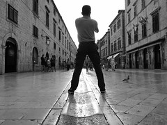 Triangular relationship ... (Klaus Wessel) Tags: olympus dubrovnik kroatien oldcity altstadt beziehung beine dreieck bw blackwhite monochrome street streetlife