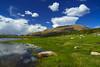 Yosemite High Country Blue & Green (RobertCross1 (off and on)) Tags: a7rii alpha ca california emount fe1635mmf4zaoss ilce7rm2 sierranevada sierras sony spillwaylake yosemite yosemitenationalpark bluesky clouds fullframe grass lake landscape meadow mirrorless mountains reflection water