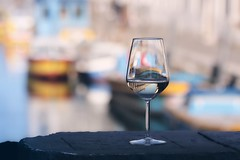 Wine is sunlight, held together by water (Galilei) (Janette Paltian) Tags: janettepaltian 650d canon 70200 wine glass venice venedig harbour water boat boot wineglass weinglas light licht italien italy colourful farbig dof depthoffield tiefenschärfe schärfentiefe