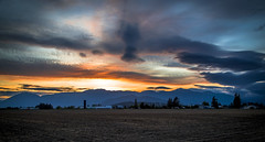 Chilliwack Sunset (Paul Rioux) Tags: chilliwack bc sunset dusk evening farm barn rural country agriculture agricultural scenic field crops mountains clouds prioux