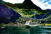 Geiranger, Norway (gwpics) Tags: cruise landscape woods water mountains scandinavia township economy holiday sea fjord geiranger summer ship norway shipping norwegian forest leisure cruiseliner mountainous green craft tourism marine sunnmøre fiord village