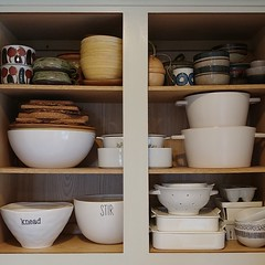 We interrupt this #springcleaning to bring you #organizing.1of2 #kitchencabinet #shelves #toptobottom: #thrifted #pottery #collection, #servingdish(es) & #cork #trivets, #mixingbowl(s) #porcelain #colander(s) & #berrycrate(s)#organize #kitchen #cabinet #s (Heath & the B.L.T. boys) Tags: instagram rental home kitchen cabinet organize pottery thrift words bowls acorn twine ikea cratebarrel westelm cb2 cork white