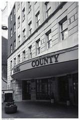 County Hotel (peterphotographic) Tags: img007edwm countyhotel xp2 disposable disposablecamera 35mm film analog scanned ©peterhall blackandwhite blackwhitephotos bw monochrome euston london england uk britain hotel building porch architecture entrance streetphotography street urban