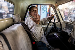 A candid shot in Mexico (Frederik Trovatten) Tags: streetphotography portrait portraits streetphotographer photographer mexico candid colors car man hombre guy old sitting city fuji x100f x1004 cigarette eyecontact mexican