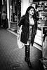 Boots (Kieron Ellis) Tags: blackandwhite blackwhite street woman candid boots bag necklace eyecontact