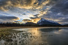 Vermilion Lakes. Banff (aud.watson) Tags: canada alberta canadianrockies albertasrockies banffnationalpark banff vermilionlakes vermilionlakesroad mountains mountain valley valleys peak dawn sunrise sky cloud clouds lake lakes water shore shoreline grass reeds forest wood conifers pine pines spruce marsh reflections