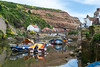 Staithes, North Yorkshire (Louisa Rose Mack) Tags: staithes northyorkshire yorkshire england northernengland upnorth uk locationscout cebeebies screenyorkshire scarborough seaside holiday fishing fishingport harbour sea sun boats water reflection