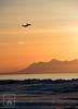 Plane Sunset (fentonphotography) Tags: alaska sunset plane orangesky landscape water cookinlet alaskarange silhouette ice shore mountains winter