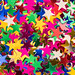 Colorful star sequin glitter textured background abstract