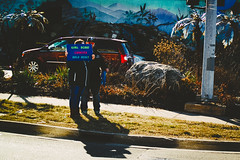 DriveBy 1741: Girl Scout Cookiescape (Dimi Sahn) Tags: motion driving cookies sign candid portrait street