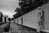 Wall Of The Missing (aquanout) Tags: blackandwhite monochrome statues memorial trees war paving