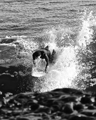 Cutting the Trench (Santa Cruz Pictographer) Tags: surfing surfer water ocean sea wave beach shore splash cutting slicing foam board determination intense action black white bw grey gray