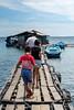 Balancing act (Stinkee Beek) Tags: lombok adi autorepearlfarm erin ethan