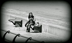 Seated skateboarder (* RICHARD M (7.5 MILLION VIEWS)) Tags: street candid mono blackwhite skateboard seat skateboarder benches eatingout dinnerforone alfresco lunchtime lunch takeaway solitary beards bearded whiskers bewhiskered beardedskateboarder horns devillish sand beach beaches sandybeach railings seawall ironrailings seaside sunnysouthport southport sefton merseyside shore alone