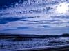 Winters Blues (darletts56) Tags: sky blue clouds snow prairie fence road gravel sun