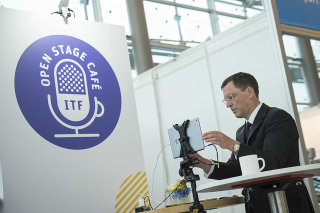 Attendee setting up at the ITF Open Stage Café
