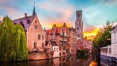 Bruges on Fire (Kenneth J. Garcia) Tags: architecture belfortvanbrugge belfry belgium brick bruges canal dijver europe photospecs reflections rozenhoedkaai stockcategories sunset time tower urbanism brugge vlaanderen be