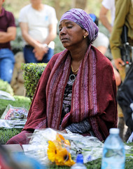 "Sometimes, it's hard to ""imagine all the people, living life in peace"" (ybiberman) Tags: israel jerusalem mountherzl militarygraveyards women portrait crying tears grave veil candid streetphotography people immigrant ethiopia flowers"