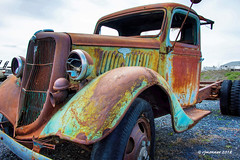 Old Ford_187307 (rjmonner) Tags: truck antique ford rusted patina old neglected automotive restore restorable fender horn tire wheel grille v8 broken idaho northwest bumper hood runningboard duelwheels frame relic rural rustic rust used oldtimer rebuild tires 1935