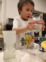Science is serious business - Liam measuring water (avlxyz) Tags: liam lfb science water