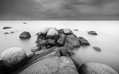 stone hopping (chocoorange) Tags: stone beach bw blacknwhite belitung indonesia