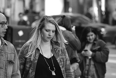 People on Market St 19 (TheseusPhoto) Tags: blancoynegro blackandwhite monochrome noir people citylife city streetphotography street sanfrancisco marketstreet candids candid girl woman