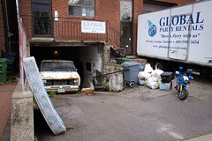 Have a Party with us (Vic Gedris) Tags: toronto ontario canada party rental van truck mattress derelict creepy garbage junk rust geary gearyave driveway business storefront toy motorcycle globalpartyrentals