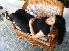 Relaxation time - natural hair drying:) (sean and nina) Tags: nina woman female girl lady girlfriend fiancee wife married brunette dark hair brown eyes pink lips gorgeous stunning charm charming beauty beautiful amazing serb veranda sofa wicker chair settee cushion black clothes tee shirt trousers shoes long pose posed posing petrinja croatia croatian summer hot warm resting stretched out outside outdoor people persons furniture eu europe european arms throat neck bare skin tan tanned ankles