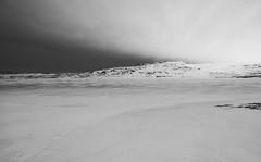 Approaching storm [explored] (B o t o n d) Tags: baulárvallavatn iceland winter landscape mountain nature snow frozen lakebaularvellir ice rain storm clouds monochrome blackandwhite icelandic ísland