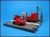 Team Red and Support Truck (Karf Oohlu) Tags: lego moc microscale car racecar truck road vignette streetliht